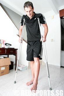Aleks on crutches
