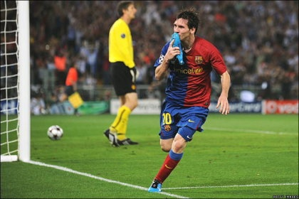 5d8d5614792f Lionel Messi of Barcelona kisses his boot in celebration after scoring the  second goal in the 2-0 victory over Manchester United in the recent  European ...