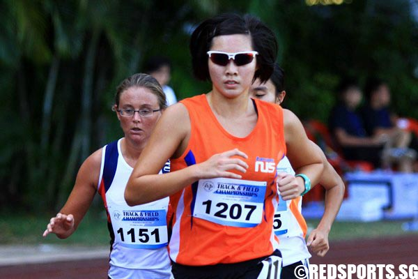 Clara wong (#1207) of NUS finishing 1st with a time of 11:14.41.