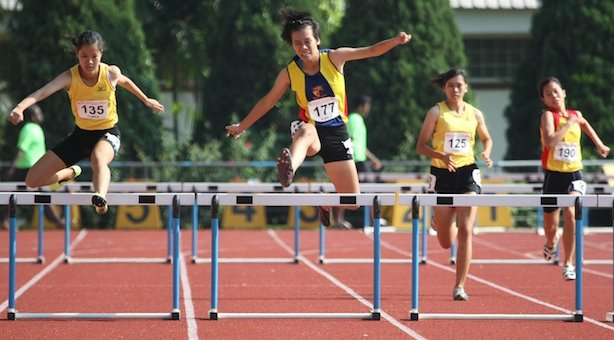 A Div 400m Hurdles: Clarice Mak of Victoria Junior College comes from behind to win gold in 68.30s