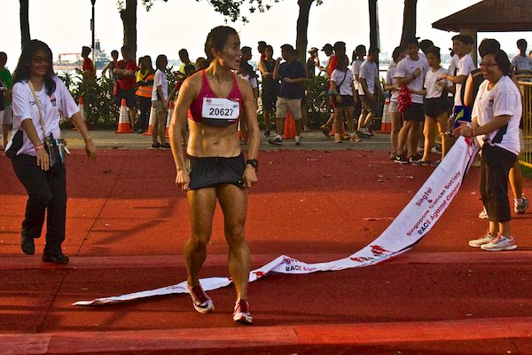 Race against cancer mok ying rong improves by 31s to win 15km race in