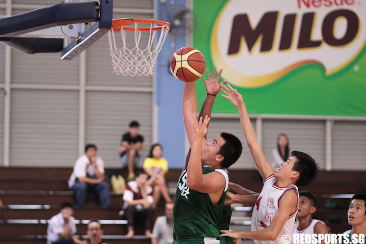 Wong Chee Kian (AIS #15) goes up for the basket.