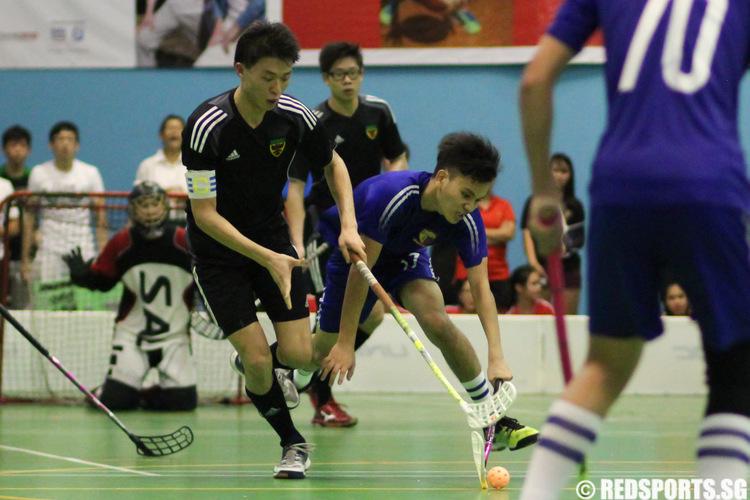 Benjamin Kristano (ACJC #97) controls the ball against Zhang Zhen Ming (RI #9).