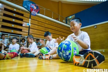Children aged 12 and below pick up basic skills at ActiveSG introductory basketball camp