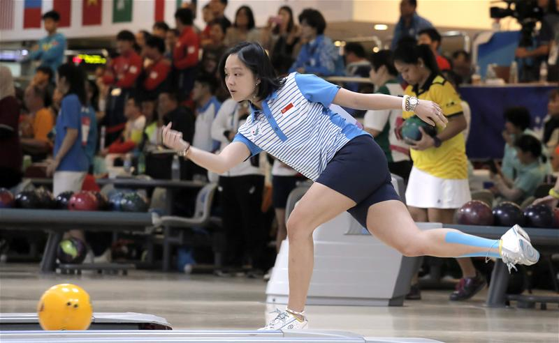 Jazreel Tan in action during the women's singles event and en route to winning silver. (Photo 7 courtesy of Vivek Prakash / Sport Singapore via Action Images Livepic)