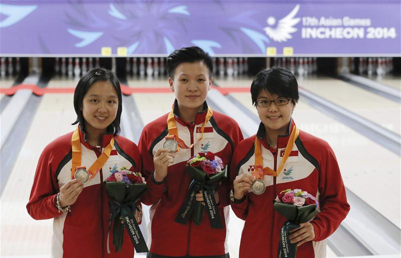 The team of (from left) Jazreel Tan, New Huifen, and Cherie Tan won silver in the women's trios event. It was Jazreel's and Singapore's second silver in bowling at the Asiad. (Photo 3 courtesy of Vivek Prakash/Sport Singapore via Action Images Livepic)