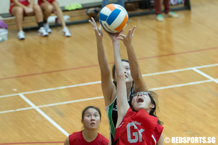 Shu Ning (GK) or River Valley High School intercepts a pass made to Isabelle (GS) of Raffles Institution. (Photo © Lee Jian Wei/Red Sports)