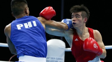 Tay Jia Wei (Red) of Singapore and Eumir Felix Marcial (Blue) of Philippines in action during the Men's Welterweight (69kg) Finals. (Photo © Lee Jian Wei/Red Sports)