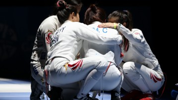 Teammates Rania, Victoria and Elizabeth console Cheryl after losing to Philippines 29–28 in the Women's Team Epee semi-finals. The team settled for the bronze medal. (Photo © Lee Jian Wei/Red Sports)