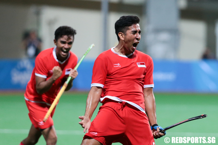 Enrico Marican (#5) celebrates after scoring a crucial equaliser against Malaysia in the dying minutes of the second half. (Photo © Lee Jian Wei/Red Sports)