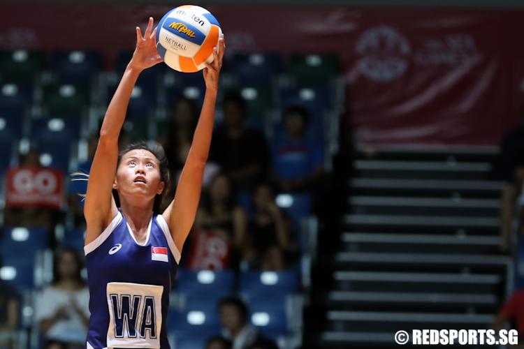 Chen Huifen (WA) of Singapore jumps to intercept a pass. (Photo 5 © Lee Jian Wei/Red Sports)