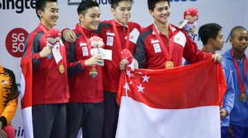 (L-R) Quah Zheng Wen, Pang Sheng Jun, Danny Yeo and Joseph Schooling pose for a photo after clinching gold in the Men's 4x200m Freestyle event. They set a new national and games record with a time of 7 minutes and 18.14 seconds. (Photo © Lee Jian Wei/Red Sports)