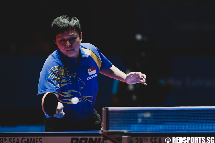 Li Hu (SIN) plays a forehand drive during the finals of the Mens' team Table Tennis. (Photo 1 © Soh Jun Wei/Red Sports)