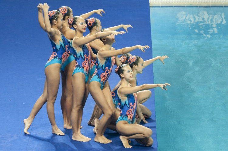 The Singapore team beautifully posed at the start of their Synchronised Swimming Team Free Routine Finals. They went on to win gold in the Team Technical and Free Routine event held at the OCBC Aquatic Centre. (Photo © Low Sze Sen/Red Sports)