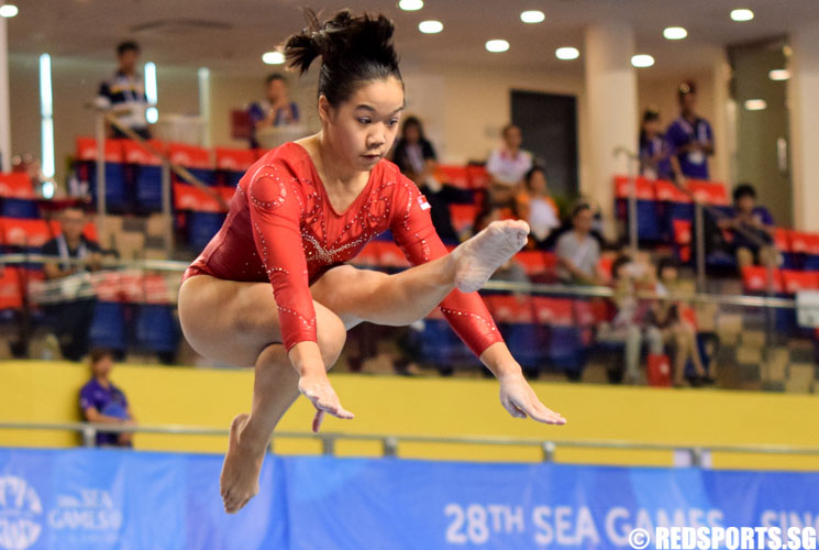 Ashley Lau executing a wolf jump. Ashley finished eighth in the Women's Balance Beam Final held at Bishan Sports Hall. (Photo 1 © Laura Lee/Red Sports)