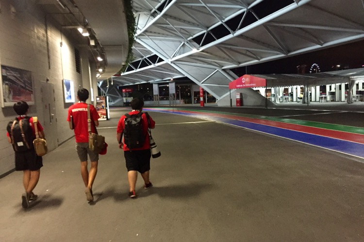 Red Crew (L-R) Jerald Ang, Koh Yizhe, and Matthew Lau going home after a day of reporting. (Photo by Les Tan/Red Sports)