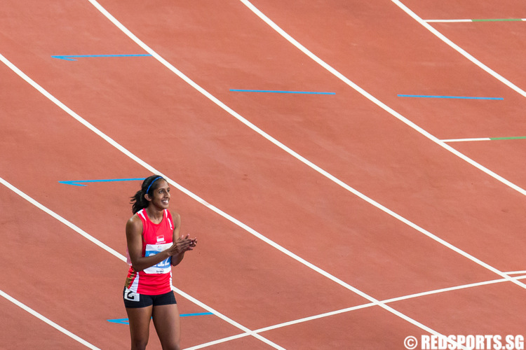 Veronica Shanti Pereira of Singapore reacts after clinching the women's 100m bronze medal. (Photo 2 © Lim Yong Teck/Red Sports)