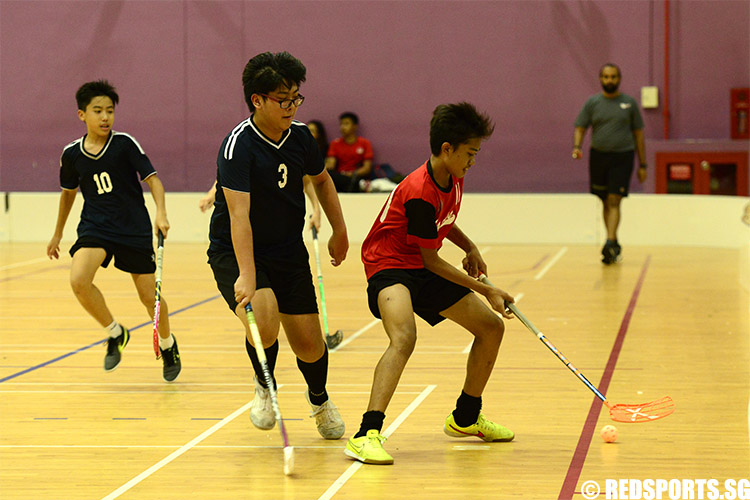Azhari Saputra B Mustaf (#11) handles the ball against AES. Azhari was the top scorer of the game with six goals. (Photo 1 © Louisa Goh/Red Sports)