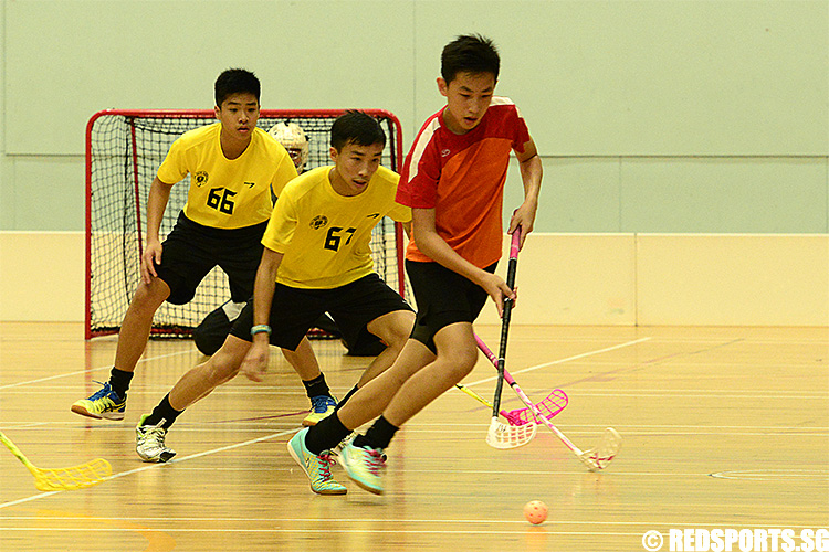 Amos Pang (BDS #7) handles the ball away from Victoria School. (Photo 3 © Louisa Goh/Red Sports)