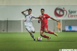 Kung Jin Song (DPRK #5) fights for possession of the ball against Jordan Vestering (SIN #3) during the 2016 Asian Football Confederation (AFC) U-16 Championship Qualifiers. (Photo 2 © Soh Jun Wei/Red Sports)