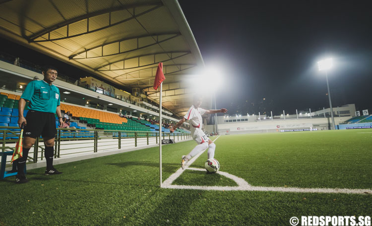 Yun Min (DPRK #17) taking a corner kick in the first half of the  the 2016 Asian Football Confederation (AFC) U-16 Championship Qualifiers. (Photo 7 © Soh Jun Wei/Red Sports)