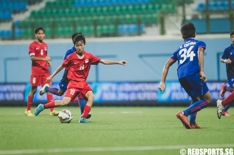 Joel Chew (SIN #19) attempts a shot during the first half of the 2016 Asian Football Confederation (AFC) U-16 Championship Qualifiers. (Photo 1 © Soh Jun Wei/Red Sports)