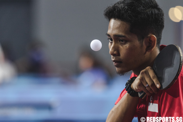 Muhammad Dinie Asyraf Bin Huzaini (SIN) preparing to serve the ball during the Men's Team Table Tennis Round 1 Match 2 of the 8th ASEAN Para Games. (Photo 5 © Soh Jun Wei/Red Sports)