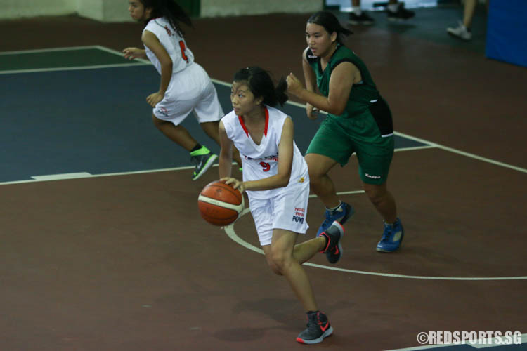 Kho Kai Ting (NA #9) drives up the court after a rebound. She scored a game-high 10 points leading her team to victory. (Photo 1 © REDintern Chua Kai Yun)