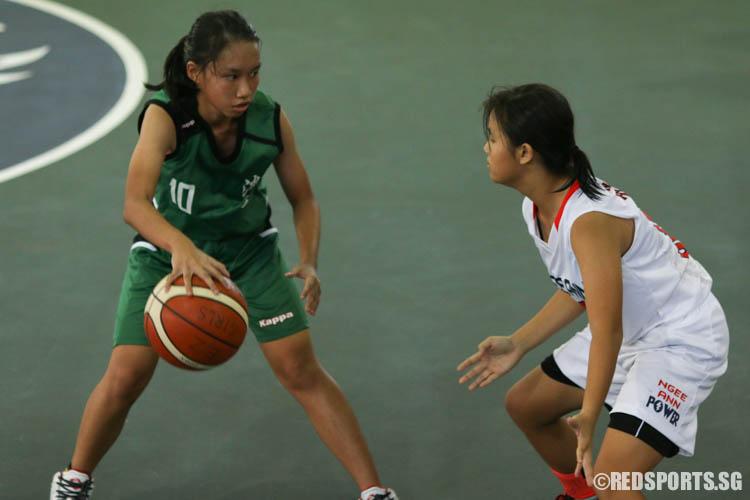 Whitney Goh (TJ #10) guards the ball warily. She scored a team-high 5 points. (Photo 2 © REDintern Chua Kai Yun)