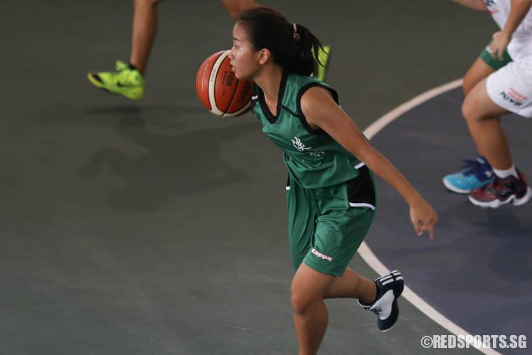 Antrusha (TJ #12) drives up the court on a fast break. (Photo 6 © REDintern Chua Kai Yun)