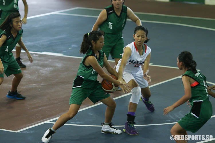 Kellyn (TJ #5) successfully gained possession of the ball. (Photo 8 © REDintern Chua Kai Yun)