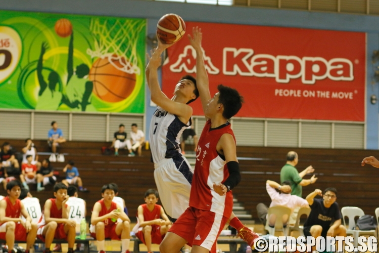 YX (Yishun #7) being contested by his defender as he goes for a layup. (Photo  © REDintern Chan Hua Zheng)