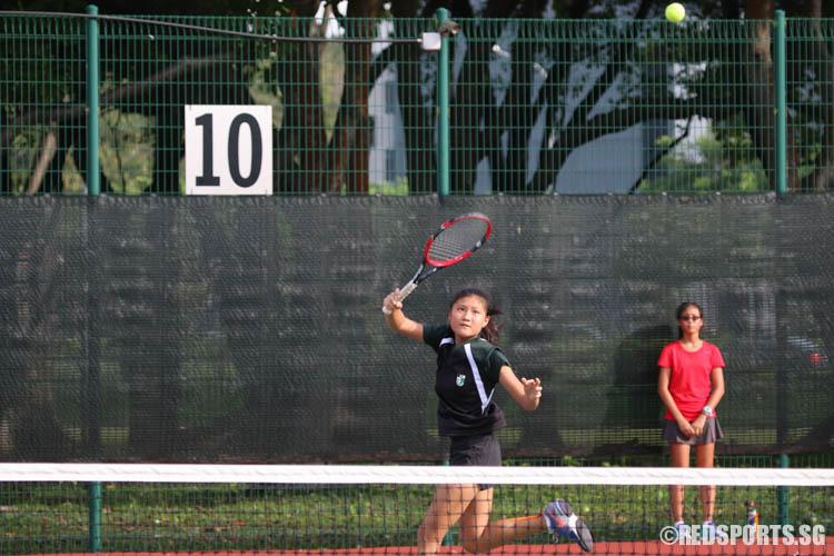 Captian Meg Ang of Raffles Girls' School prepares to execute an overhead shot against Tamara Tan of Methodist Girls' School. Ang won the match 6-2, 6-4. (Photo 1 © Chua Kai Yun/Red Sports)