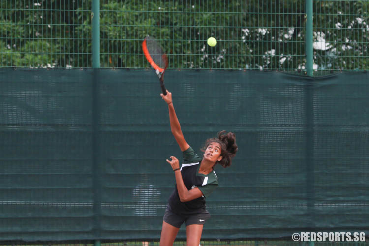 Shirina Mulani of Raffles Girls' School serves against Methodist Girls' School during the deciding 2nd Doubles. RGS won the match 6-4,6-4. (Photo 3 © Chua Kai Yun/Red Sports)