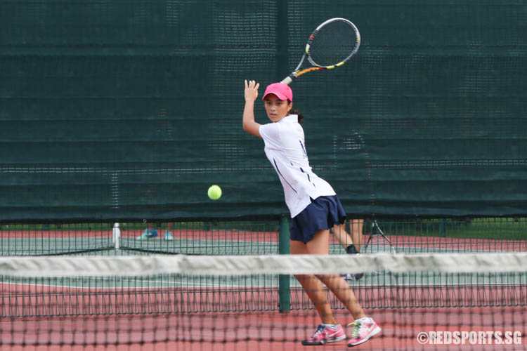 Emma Colins of Methodist Girls' School plays a forehand groundstroke against Raffles Girls' School during the 2nd Doubles. MGS lost the match. (Photo 4 © Chua Kai Yun/Red Sports)