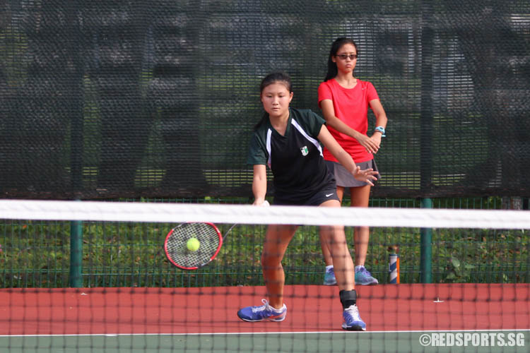Meg Ang of Raffles Girls' School plays a forehand groundstroke against Tamara Tan of Methodist Girls' School. (Photo 6 © Chua Kai Yun/Red Sports)