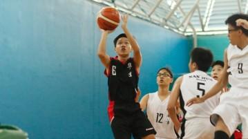 Ryan Huang (Hua Yi #6) pulls up for a shot. He had 9 points in the victory. (Photo  © Chan Hua Zheng/Red Sports)