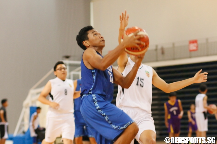 Razzif B Ismail (HIH #20) on his way to the basket. He scored a game-high 17 points in the victory. (Photo 2 © Dylan Chua/Red Sports)