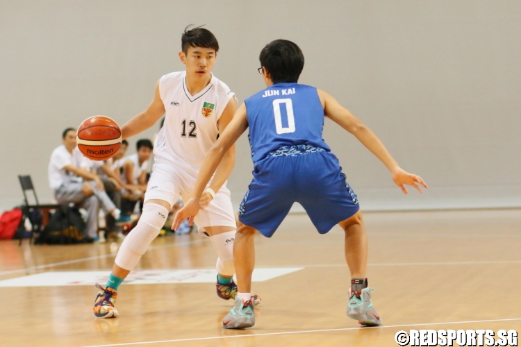 Bryan Teo (RI #12) looks to attack his opponent. He finished the game with 11 points. (Photo 1 © Dylan Chua/Red Sports)