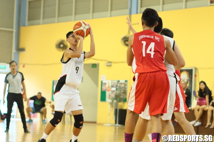 Renneth Tan Zi Jun (Woodgrove #9) pulling up for three. He scored 9 points in the victory. (Photo  © Chan Hua Zheng/Red Sports)