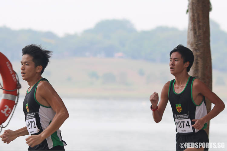 Chester Lee (#1072) and Tan Chong Qi (#1074) in action. Lee finished third with a timing of 16:31.38, while Tan finished second with a timing of 16:26.25. (Photo © Chua Kai Yun/Red Sports)