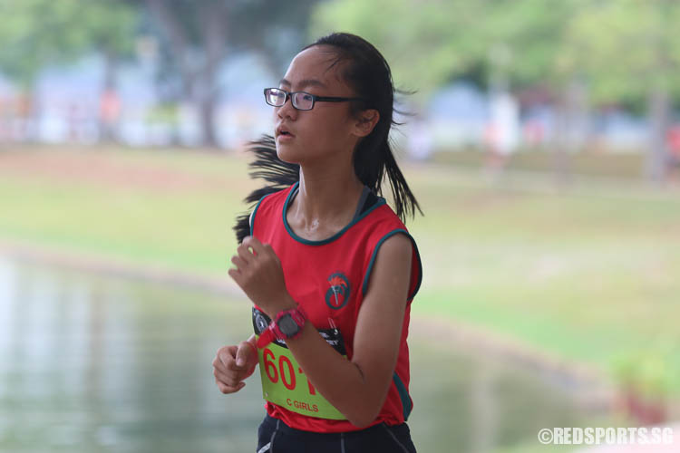 Lui Jing Wen (#6011) of Ahmad Ibrahim finished fifteenth with a timing of 17:06.26. (Photo © Chua Kai Yun/Red Sports)