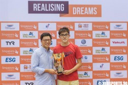Darren Chua receives the Most Valuable Swimmer award at the 47th Singapore National Age Group Swimming Championships. He clinched three individual golds. (Photo © Soh Jun Wei/Red Sports)