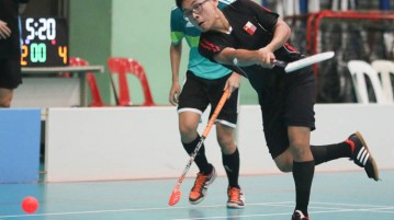 Kwek Kang Ying (#2) of NJC attempts a shot. (Photo © Chua Kai Yun/Red Sports)