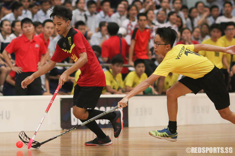 Muhammad Hakim B Selamat (EVS #10) dribbles the ball while Joel Sim attempts to steal possession.  (Photo © Chua Kai Yun/Red Sports)