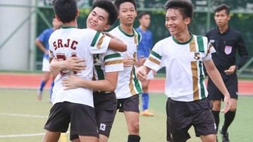 Players from Serangoon Junior College celebrate as Jove Liew (#21) scores their third goal. (Photo © Chua Kai Yun/Red Sports)