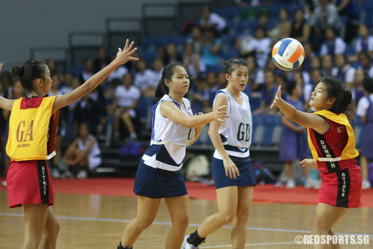 Wan Qing (C) of CHIJ (Toa Payoh) fires a pass against her opponent. (Photo © Chua Kai Yun/Red Sports)