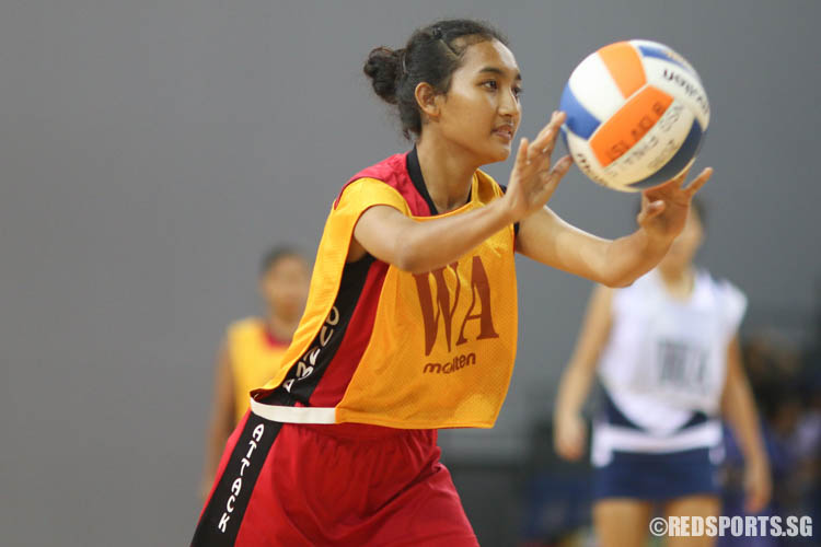 (WA) of Dunman plays against CHIJ (Toa Payoh). (Photo © Chua Kai Yun/Red Sports)