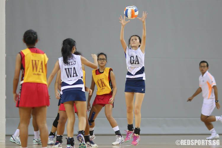 Claudia Yip (GA) of CHIJ (Toa Payoh) catches the ball. (Photo © Chua Kai Yun/Red Sports)
