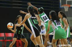 Qi En (C) of RGS faces tight defence. (Photo © Chua Kai Yun/Red Sports)